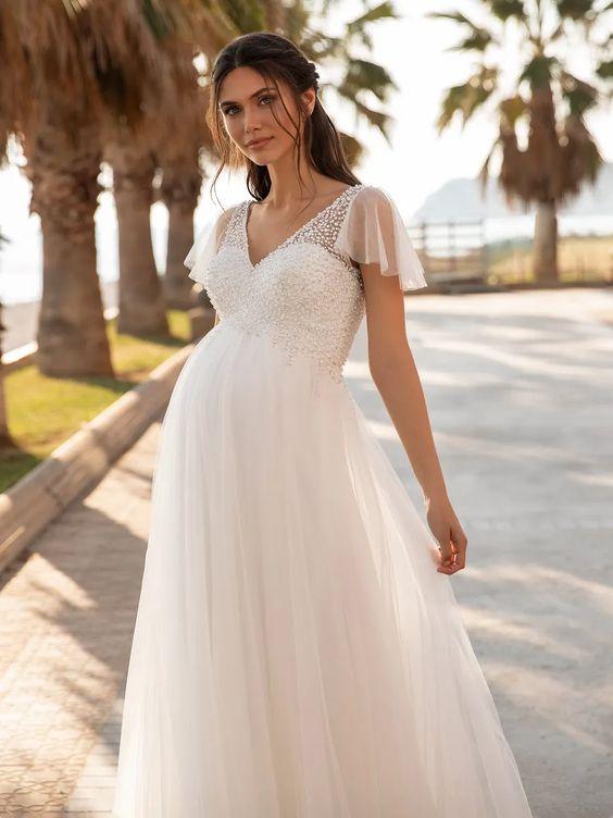 chọn váy cưới cho cô dâu bầu